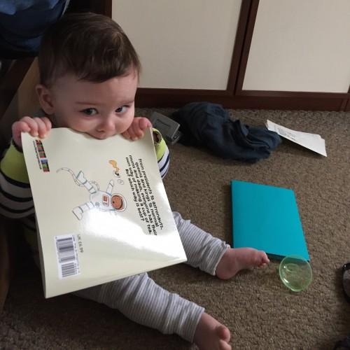 My little monster enjoying eating the book!